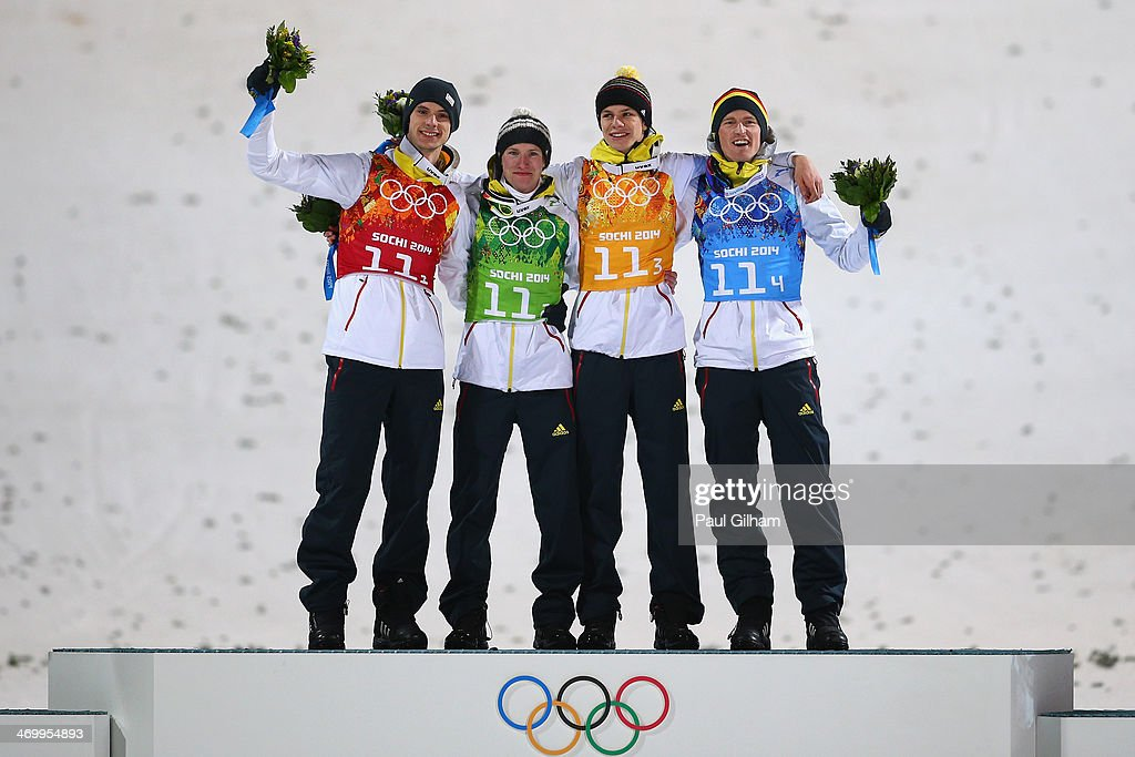 Gold medalists Andreas Wank, <a gi-track='captionPersonalityLinkClicked' href=/galleries/search?phrase=Marinus+Kraus&family=editorial&specificpeople=11675455 ng-click='$event.stopPropagation()'>Marinus Kraus</a>, <a gi-track='captionPersonalityLinkClicked' href=/galleries/search?phrase=Andreas+Wellinger&family=editorial&specificpeople=8795492 ng-click='$event.stopPropagation()'>Andreas Wellinger</a> and <a gi-track='captionPersonalityLinkClicked' href=/galleries/search?phrase=Severin+Freund&family=editorial&specificpeople=4780594 ng-click='$event.stopPropagation()'>Severin Freund</a> of Germany celebrate during the flower ceremony for the Men's Team Ski Jumping final round on day 10 of the Sochi 2014 Winter Olympics at the RusSki Gorki Ski Jumping Center on February 17, 2014 in Sochi, Russia.