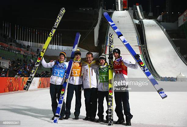 Gold medalists Andreas Wank Marinus Kraus Andreas Wellinger and Severin Freund of Germany celebrate with Alfons Hoermann DOSB president after the...