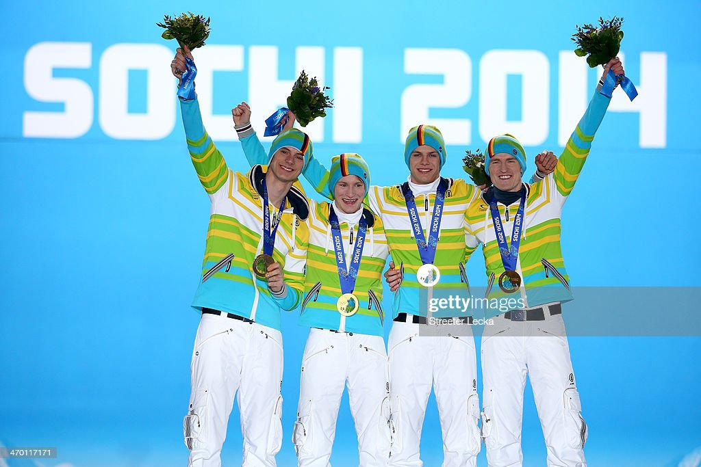 Gold medalists <a gi-track='captionPersonalityLinkClicked' href=/galleries/search?phrase=Andreas+Wank&family=editorial&specificpeople=2507492 ng-click='$event.stopPropagation()'>Andreas Wank</a>, <a gi-track='captionPersonalityLinkClicked' href=/galleries/search?phrase=Marinus+Kraus&family=editorial&specificpeople=11675455 ng-click='$event.stopPropagation()'>Marinus Kraus</a>, <a gi-track='captionPersonalityLinkClicked' href=/galleries/search?phrase=Andreas+Wellinger&family=editorial&specificpeople=8795492 ng-click='$event.stopPropagation()'>Andreas Wellinger</a> and <a gi-track='captionPersonalityLinkClicked' href=/galleries/search?phrase=Severin+Freund&family=editorial&specificpeople=4780594 ng-click='$event.stopPropagation()'>Severin Freund</a> of Germany celebrate during the medal ceremony for the Men's Team Ski Jumping on day 11 of the Sochi 2014 Winter Olympics at Medals Plaza on February 18, 2014 in Sochi, Russia.