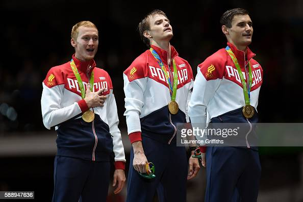Gold medalists Artur Akhmatkhuzin Alexey Cheremisinov and Timur Safin of Russia celebrate on the podium for the Men's Team Foil event on Day 7 of the...