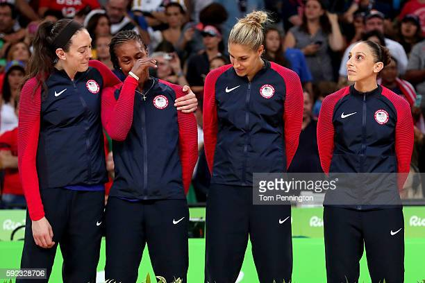 Gold medalists Breanna Stewart Tamika Catchings Elena Delle Donne and Diana Taurasi of United States celebrate during the medal ceremony after the...