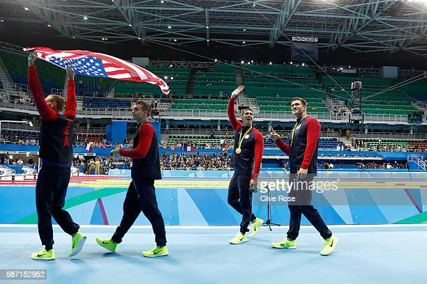 Gold medalists Caeleb Dressell Michael Phelps Nathan Adrian and Ryan Held of the United States during the medal ceremony for the Final of the Men's 4...
