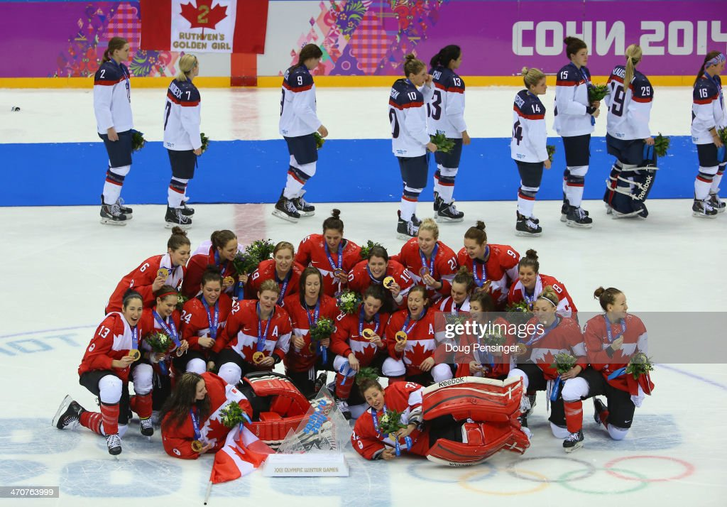 Gold medalists Canada celebrate during the flower ceremony as silver medalists the United States leave the ice for the Ice Hockey Women's Gold Medal Game on day 13 of the Sochi 2014 Winter Olympics at Bolshoy Ice Dome on February 20, 2014 in Sochi, Russia.