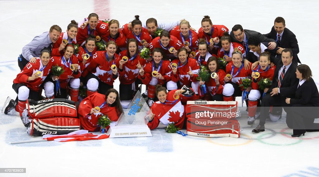 Gold medalists Canada celebrate during the flower ceremony for the Ice Hockey Women's Gold Medal Game on day 13 of the Sochi 2014 Winter Olympics at Bolshoy Ice Dome on February 20, 2014 in Sochi, Russia.