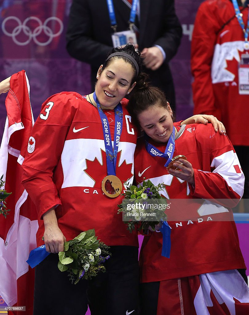 Gold medalists Caroline Oullette #13 and Melodie Daoust #15 of Canada celebrate after defeating the United States 3-2 in overtime during the Ice Hockey Women's Gold Medal Game on day 13 of the Sochi 2014 Winter Olympics at Bolshoy Ice Dome on February 20, 2014 in Sochi, Russia.