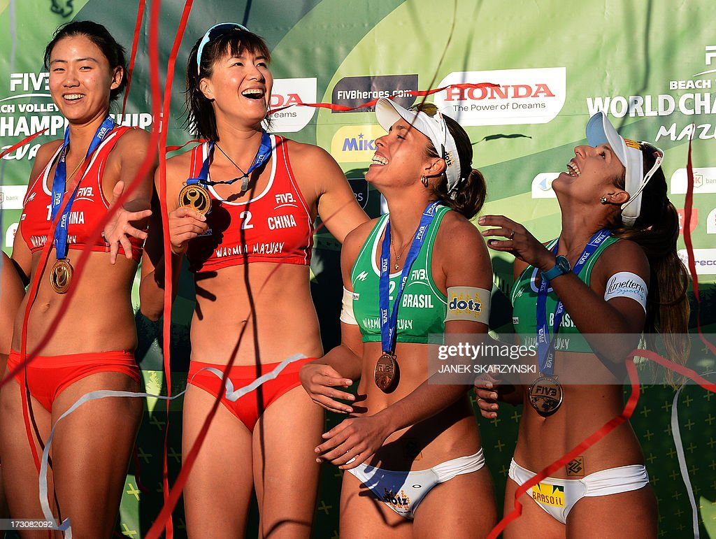Gold medalists Chen Xue (L) and Xi Zhang (2nd-L) of China stand on the podium with bronze medalists Barbara Seixas De Freitas (2nd-R) and Liliane Maestrini (R) of Brazil after the the Beach Volleyball World Championships on July 6, 2013 in Stare Jablonki, Poland.