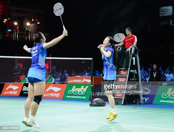 Gold medalists China's Tian Qing and Zhao Yunlei celebrate after the women's double final match at the 2014 BWF Badminton World championships held at...
