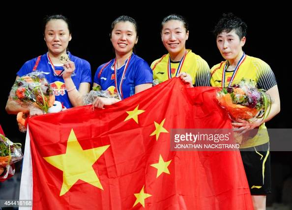Gold medalists China's Zhao Yunlei and Tian Qing and silver medalists China's Wang Xiaoli and Yu Yang celebrate on the podium after the women's...