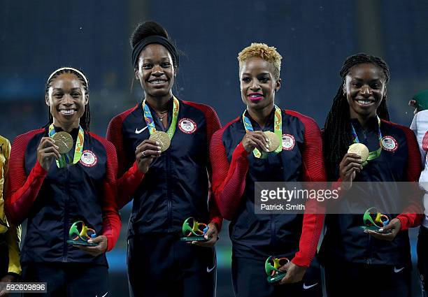 Gold medalists Courtney Okolo Natasha Hastings Allyson Felix and Phyllis Francis of the United States stand on the podium during the medal ceremony...