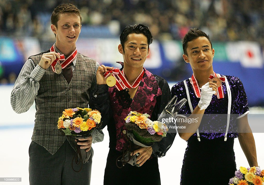 Gold medalists Daisuke Takahashi of Japan and silver medalists Jeremy Abbott of the USA and bronze medalists Florent of France poses during the medal...