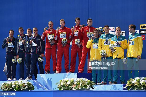 Gold medalists Daniel Wallace Robert Renwick Calum Jarvis and James Guy of Great Britain pose silver medalists Ryan Lochte Conor Dwyer and Reed...