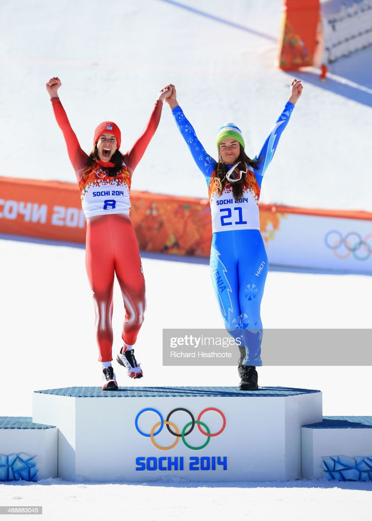Gold medalists <a gi-track='captionPersonalityLinkClicked' href=/galleries/search?phrase=Dominique+Gisin&family=editorial&specificpeople=4083154 ng-click='$event.stopPropagation()'>Dominique Gisin</a> of Switzerland (L) and <a gi-track='captionPersonalityLinkClicked' href=/galleries/search?phrase=Tina+Maze&family=editorial&specificpeople=213514 ng-click='$event.stopPropagation()'>Tina Maze</a> of Slovenia celebrate on the podium during the flower ceremony for during the Alpine Skiing Women's Downhill on day 5 of the Sochi 2014 Winter Olympics at Rosa Khutor Alpine Center on February 12, 2014 in Sochi, Russia.