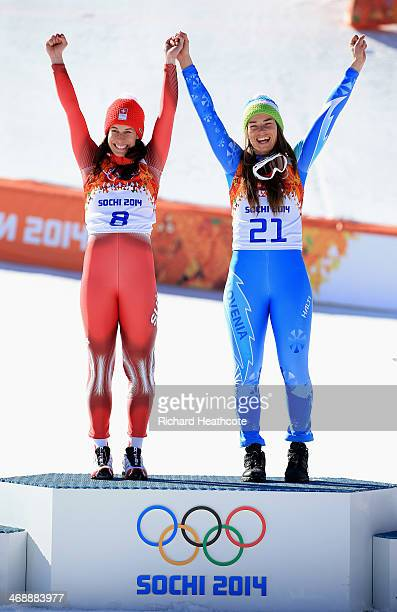 Gold medalists Dominique Gisin of Switzerland and Tina Maze of Slovenia celebrate during the flower ceremony for during the Alpine Skiing Women's...