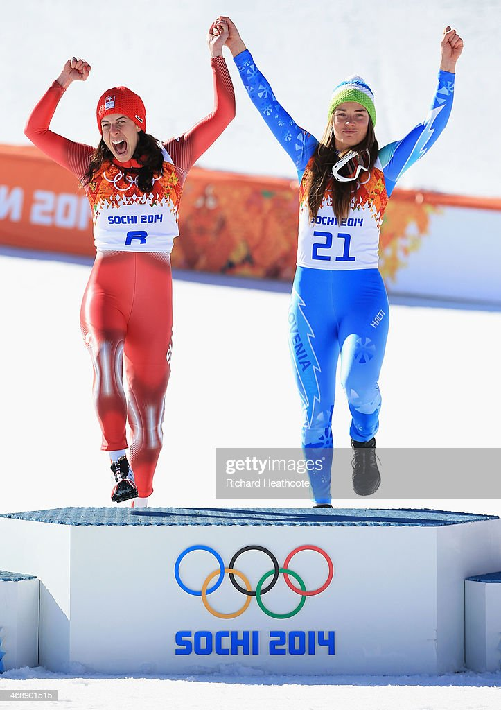 Gold medalists Dominique Gisin of Switzerland and Tina Maze of Slovenia celebrateon the podium during the flower ceremony for during the Alpine...