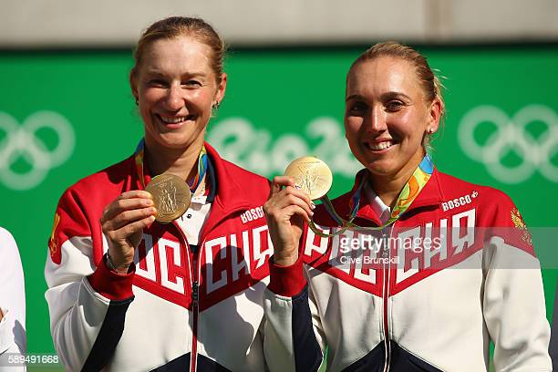 Gold medalists Elena Vesnina and Ekaterina Makarova of Russia pose on the podium during the ceremony for the women's doubles on Day 9 of the Rio 2016...
