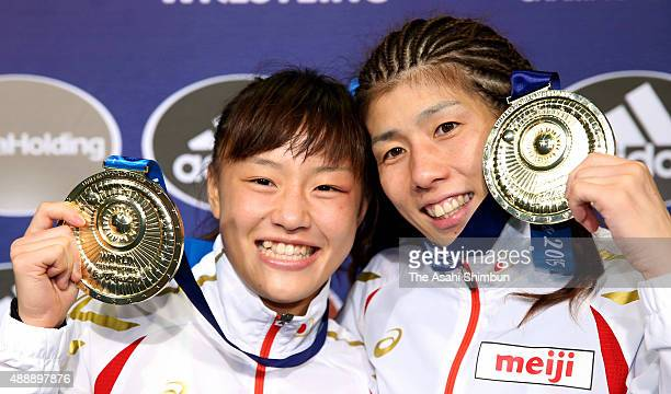 Gold Medalists Eri Tosaka of Women's 48kg and Saori Yoshida of Women's 53kg pose for photographs with their medals during day three of the World...