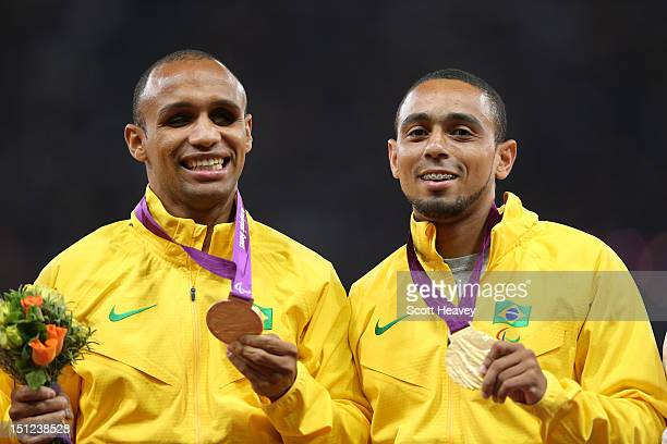 Gold medalists Felipe Gomes of Brazil and his guide Leonardo Souza Lopes pose on the podium during the medal ceremony for the Men's 200m T11 Final on...