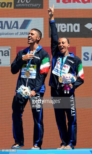 Gold medalists Giorgio Minisini and Manila Flamini of Italy pose with the medals won during the Synchronised Swimming Mixed Duet Technical final on...