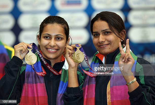 Gold medalists Heena Sidhu and Annu Raj Singh of India celebrate on the dais after victory in the 10m Air Pistol Womens Pairs event at Dr Karni Singh...