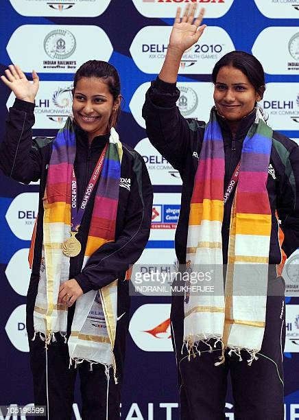 Gold medalists Heena Sidhu and Annu Raj Singh of India pose at the medal ceremony of the women's pairs 10m air pistol event of the XIX Commonwealth...