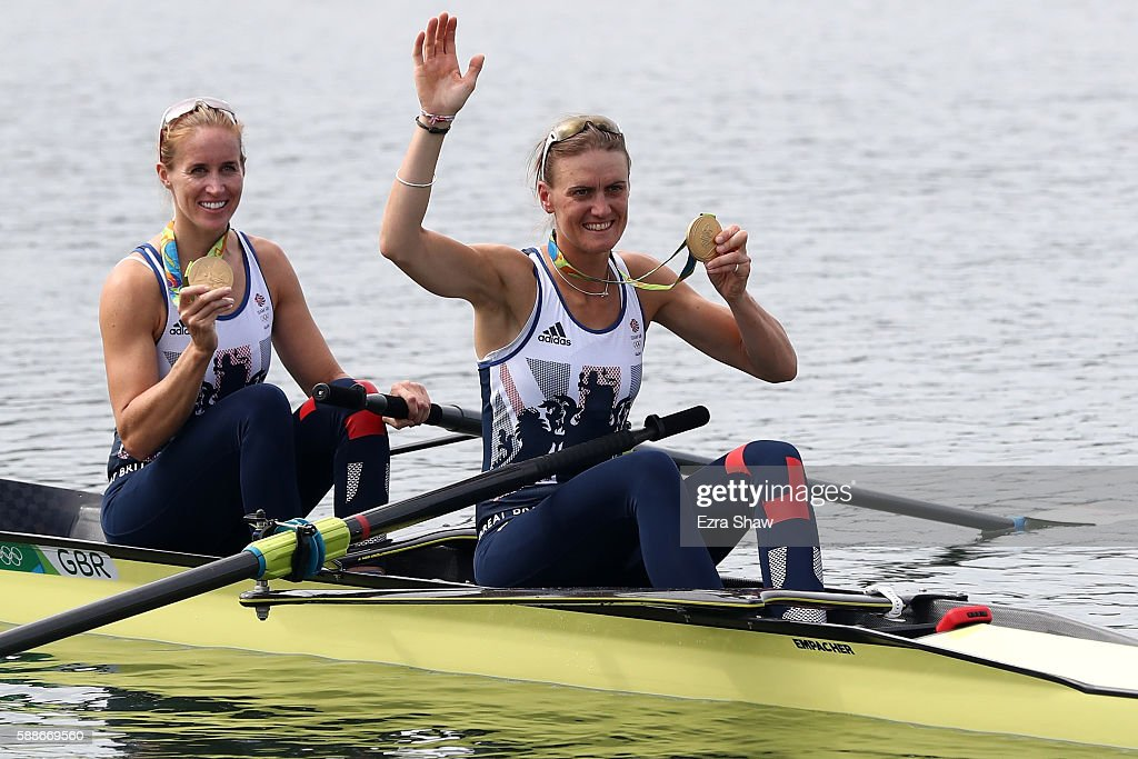 Gold medalists Helen Glover and Heather Stanning of Great Britain celebrate on their boat after the medal ceremony for the Women's Pair on Day 7 of...