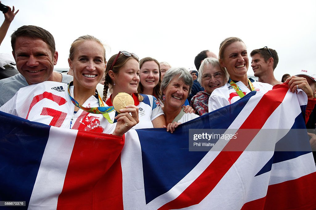 Gold medalists Helen Glover and Heather Stanning of Great Britain pose for photographs with Steve Backshall and their mothers after the medal...