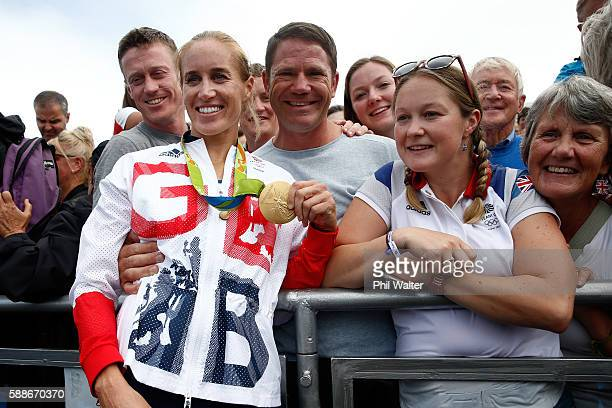 Gold medalists Helen Glover of Great Britain poses for photographs with Steve Backshall and her family to celebrate after the medal ceremony for the...
