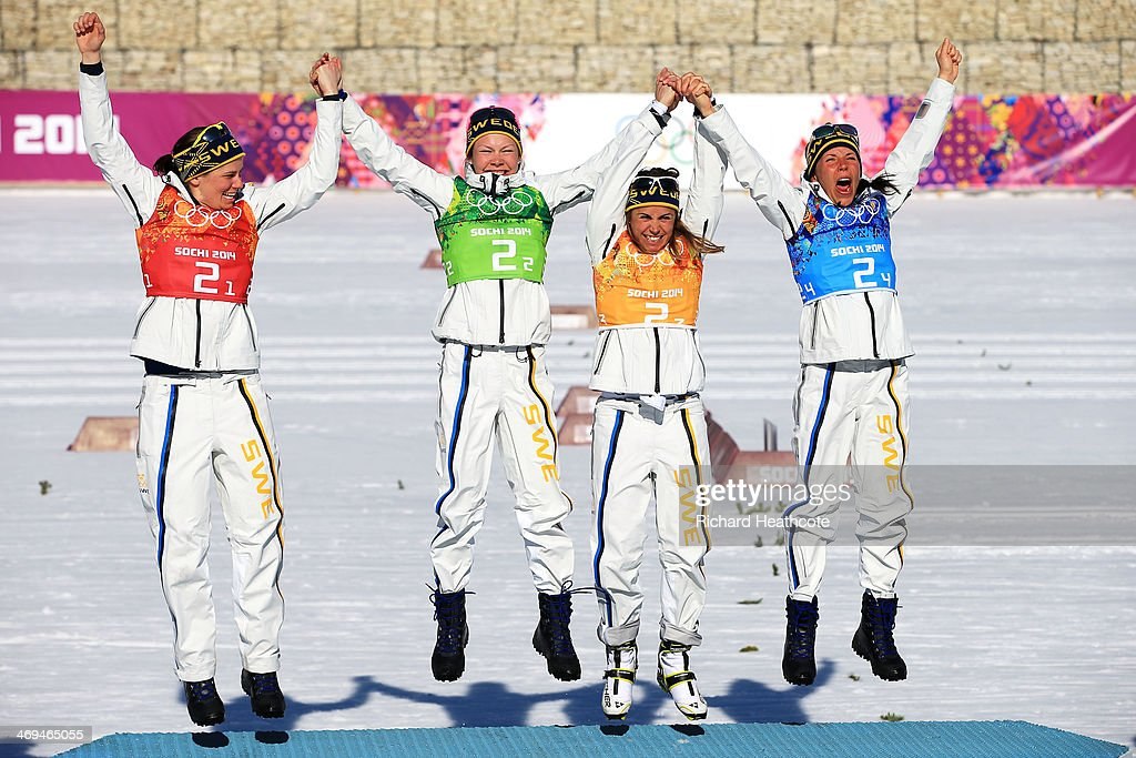 Gold medalists <a gi-track='captionPersonalityLinkClicked' href=/galleries/search?phrase=Ida+Ingemarsdotter&family=editorial&specificpeople=5640296 ng-click='$event.stopPropagation()'>Ida Ingemarsdotter</a>, Emma Wiken, <a gi-track='captionPersonalityLinkClicked' href=/galleries/search?phrase=Anna+Haag&family=editorial&specificpeople=5632130 ng-click='$event.stopPropagation()'>Anna Haag</a> and <a gi-track='captionPersonalityLinkClicked' href=/galleries/search?phrase=Charlotte+Kalla&family=editorial&specificpeople=4081474 ng-click='$event.stopPropagation()'>Charlotte Kalla</a> of Sweden celebrate on the podium during the flower ceremony for the Women's 4 x 5 km Relay during day eight of the Sochi 2014 Winter Olympics at Laura Cross-country Ski & Biathlon Center on February 15, 2014 in Sochi, Russia.