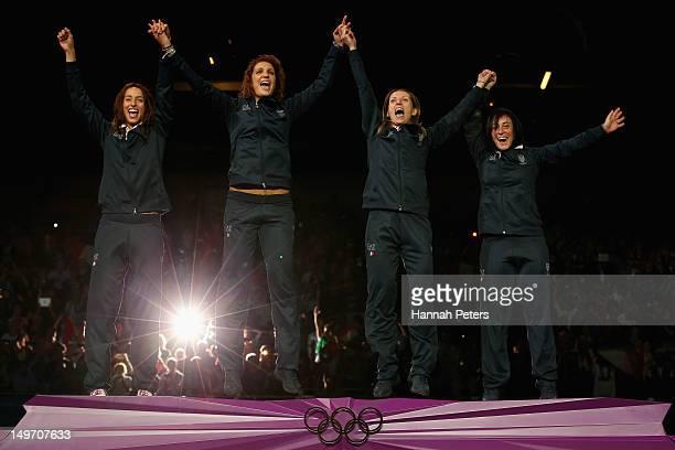 Gold medalists Ilaria Salvatori Arianna Errigo Valentina Vezzali and Elisa Di Francisca of Italy celebrate on the podium during the medal ceremony...