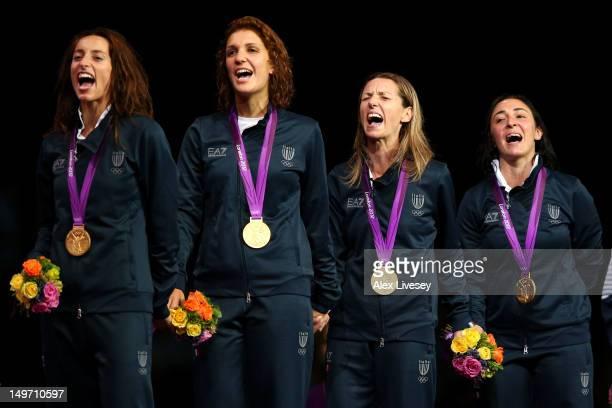 Gold medalists Ilaria Salvatori Arianna Errigo Valentina Vezzali and Elisa Di Francisca of Italy sin gtheir national anthem during the medal ceremony...