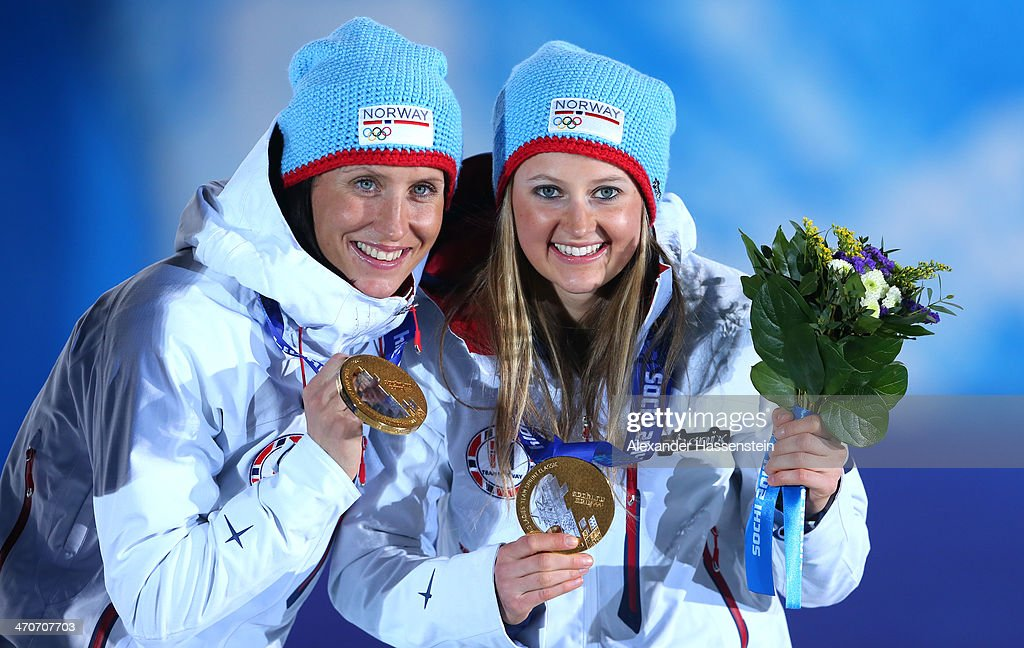 Gold medalists Ingvild Flugstad Oestberg (R) and Marit Bjoergen of Norway celebrate during the medal ceremony for the Cross Country Ladies' Team Sprint on day thirteen of the Sochi 2014 Winter Olympics at at Medals Plaza on February 20, 2014 in Sochi, Russia.