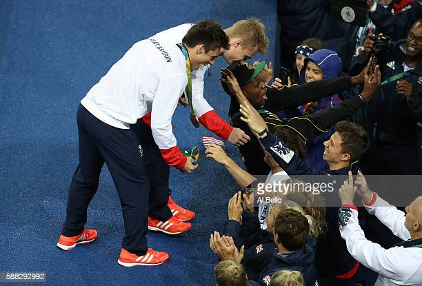 Gold medalists Jack Laugher and Chris Mears of Great Britain celebrate with team members during the medal ceremony for the Men's Diving Synchronised...