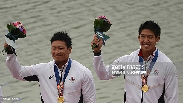Gold medalists Japan's Hiroki Fujishima and Matsushita Momotaro pose during the men's kayak double 200m medal ceremony of the 2014 Asian Games at the...