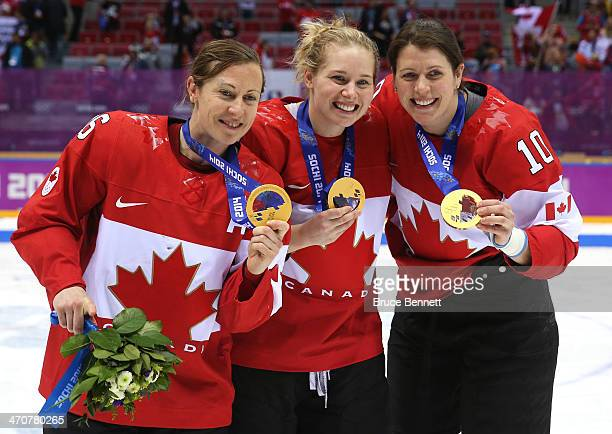 gold medalists Jayna Hefford Haley Irwin and Gillian Apps of Canada celebrate after defeating the United States 32 in overtime during the Ice Hockey...
