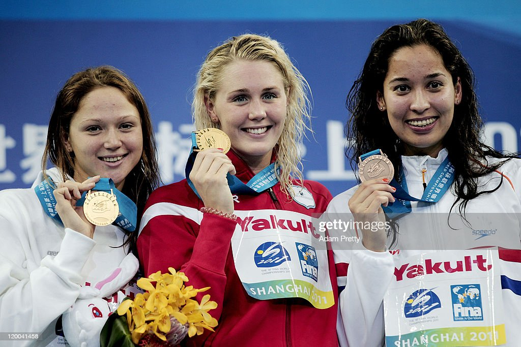 Gold medalists Jeanette Ottesen (C) of Denmark and Aliaksandra Herasimenia (L) of Belarus pose with bronze medalist Ranomi Kromowidjojo of the Netherlands after the Women's 100m Freestyle Final during Day Fourteen of the 14th FINA World Championships at the Oriental Sports Center on July 29, 2011 in Shanghai, China.