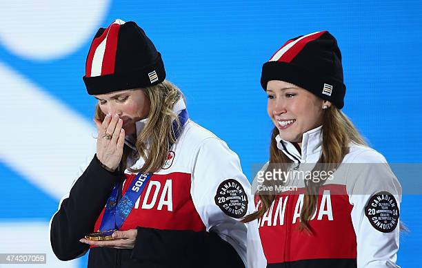 Gold medalists Jennifer Jones and Kaitlyn Lawes of Canada celebrate during the medal ceremony for Women's Curling on Day 15 of the Sochi 2014 Winter...