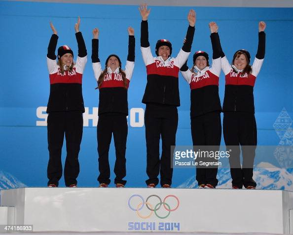 Gold medalists Jennifer Jones Kaitlyn Lawes Jill Officer Dawn McEwen and Kirsten Wall of Canada celebrate during the medal ceremony for Women's...
