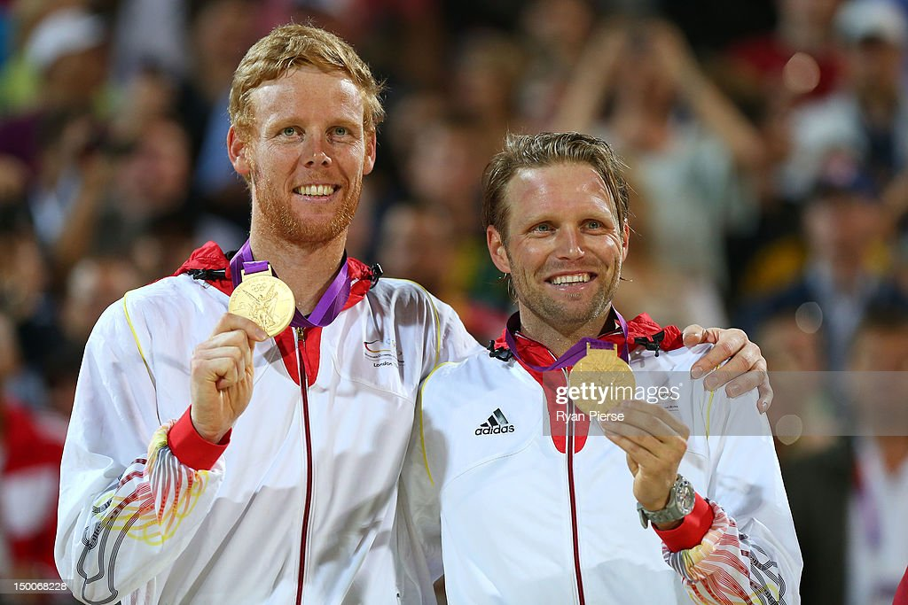 Gold medalists <a gi-track='captionPersonalityLinkClicked' href=/galleries/search?phrase=Jonas+Reckermann&family=editorial&specificpeople=228457 ng-click='$event.stopPropagation()'>Jonas Reckermann</a> and <a gi-track='captionPersonalityLinkClicked' href=/galleries/search?phrase=Julius+Brink&family=editorial&specificpeople=224931 ng-click='$event.stopPropagation()'>Julius Brink</a> of Germany celebrate with their medals during the medal ceremony for the Men's Beach Volleyball on Day 13 of the London 2012 Olympics Games at Horse Guard's Parade on August 9, 2012 in London, England.