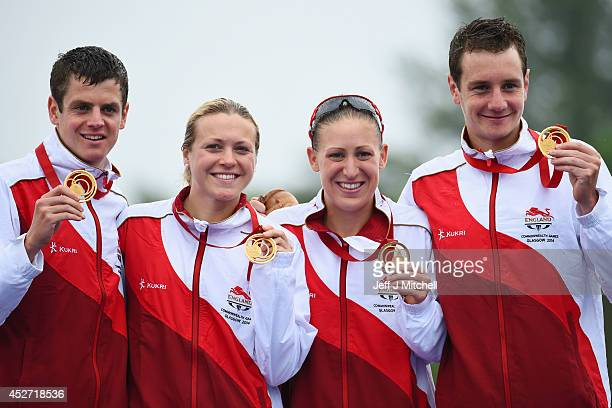 Gold medalists Jonathan Brownlee Vicky Holland Jodie Stimpson and Alistair Brownlee of England celebrate on the podium during the medal ceremony for...