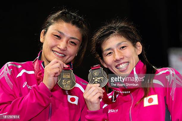 Gold medalists Kaori Icho of Women's 63kg Freestyle and Saori Yoshida of Women's 55kg Freestyle pose for photographs during day four of the FILA...