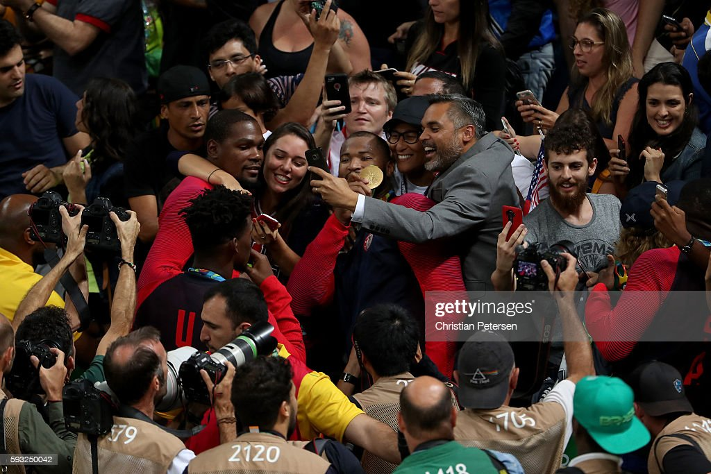 Gold medalists Kevin Durant and Carmelo Anthony of the United States celebrate with the crowd following the Men's Gold medal game on Day 16 of the...