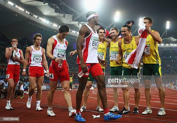Gold medalists Kevin Moore Joel Milburn Sean Wroe and Brendan Cole of Australia celebrate as Tobin Robert Richard Yates Nick Leavey and Conrad...