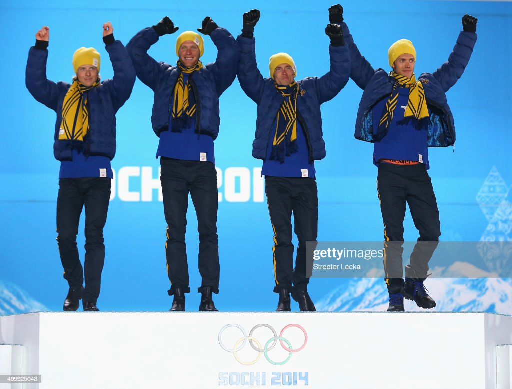 Gold medalists <a gi-track='captionPersonalityLinkClicked' href=/galleries/search?phrase=Lars+Nelson+-+Skier&family=editorial&specificpeople=12481380 ng-click='$event.stopPropagation()'>Lars Nelson</a>, Daniel Richardsson, <a gi-track='captionPersonalityLinkClicked' href=/galleries/search?phrase=Johan+Olsson&family=editorial&specificpeople=724246 ng-click='$event.stopPropagation()'>Johan Olsson</a> and <a gi-track='captionPersonalityLinkClicked' href=/galleries/search?phrase=Marcus+Hellner&family=editorial&specificpeople=4046940 ng-click='$event.stopPropagation()'>Marcus Hellner</a> of Sweden celebrate on the podium during the medal ceremony for the Cross Country Men's 4 x 10 km Relay on day ten of the Sochi 2014 Winter Olympics at the Medals Plaza on February 17, 2014 in Sochi, Russia.