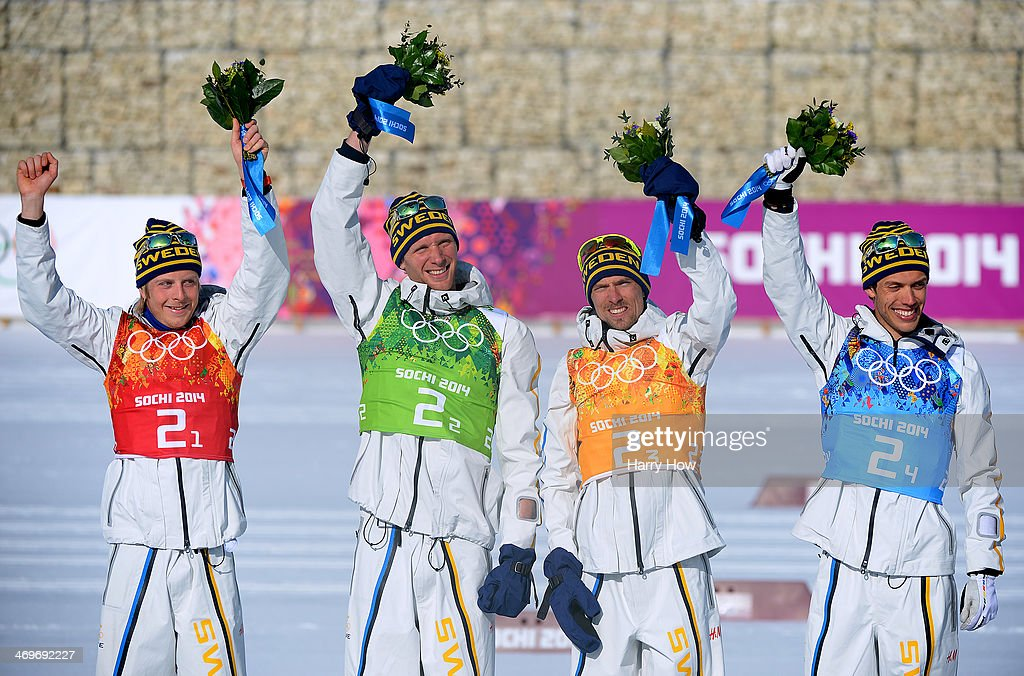 Gold medalists Lars Nelson, Daniel Richardsson, <a gi-track='captionPersonalityLinkClicked' href=/galleries/search?phrase=Johan+Olsson&family=editorial&specificpeople=724246 ng-click='$event.stopPropagation()'>Johan Olsson</a>, <a gi-track='captionPersonalityLinkClicked' href=/galleries/search?phrase=Marcus+Hellner&family=editorial&specificpeople=4046940 ng-click='$event.stopPropagation()'>Marcus Hellner</a> of Sweden celebrate on the podium during the flower ceremony for the Cross Country Men's 4 x 10 km Relay during day nine of the Sochi 2014 Winter Olympics at Laura Cross-country Ski & Biathlon Center on February 16, 2014 in Sochi, Russia.