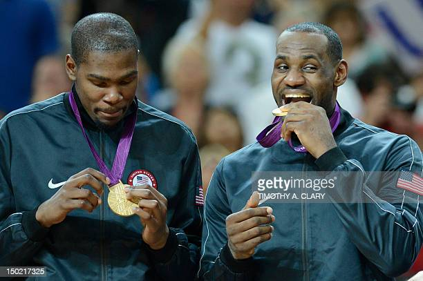 US gold medalists LeBron James and US forward Kevin Durant pose on the podium after the London 2012 Olympic Games men's gold medal basketball game...