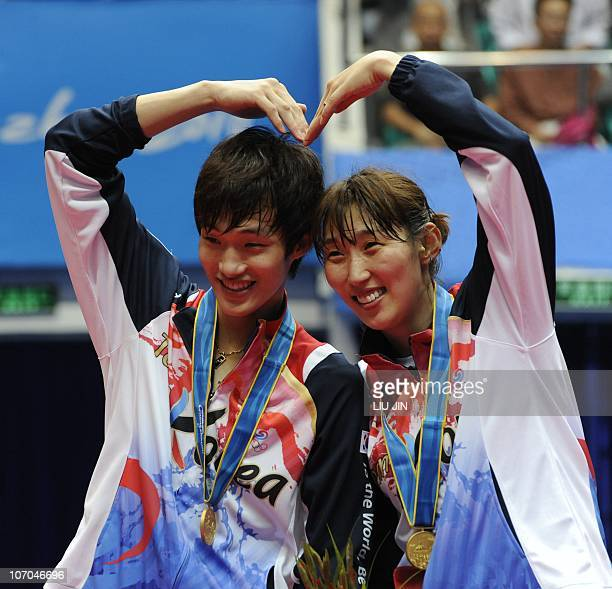 Gold medalists Lee HyoJung and Shin BaekCheol of South Korea pose on the podium during an award ceremony for their mixed doubles final against Zhang...