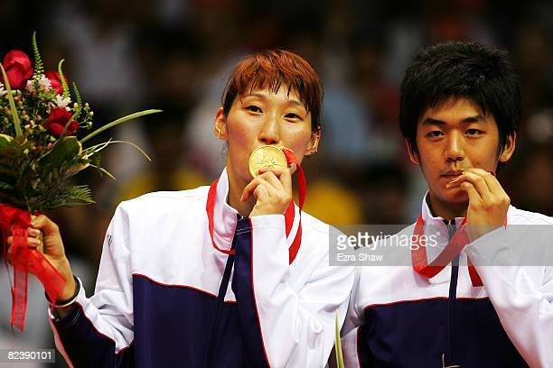 Gold medalists Lee Yongdae and Lee Hyojung of South Korea celebrate with their medals winning the Mixed Doubles Gold Medal Match against Nova...