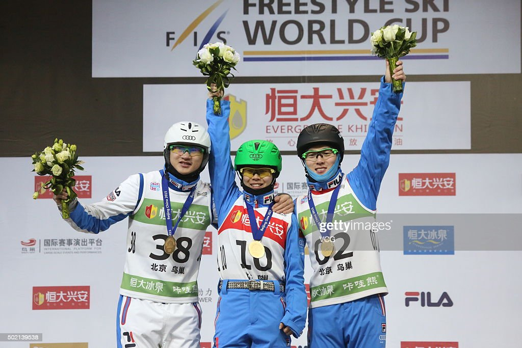Gold medalists <a gi-track='captionPersonalityLinkClicked' href=/galleries/search?phrase=Liu+Zhongqing&family=editorial&specificpeople=4132720 ng-click='$event.stopPropagation()'>Liu Zhongqing</a>, Kong Fanyu and <a gi-track='captionPersonalityLinkClicked' href=/galleries/search?phrase=Qi+Guangpu&family=editorial&specificpeople=5644886 ng-click='$event.stopPropagation()'>Qi Guangpu</a> of China celebrate on the podium after the Team Aerials Final match on day two of the 2015-2016 FIS Freestyle Ski Aerials World Cup at Birds Nest on December 20, 2015 in Beijing, China.