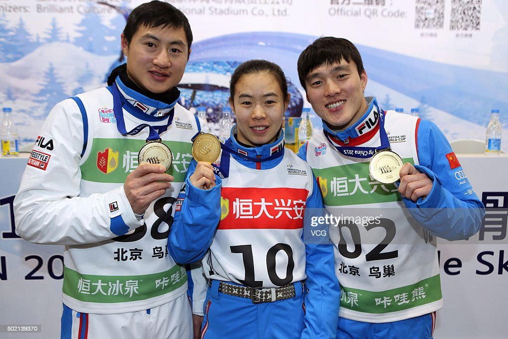 Gold medalists <a gi-track='captionPersonalityLinkClicked' href=/galleries/search?phrase=Liu+Zhongqing&family=editorial&specificpeople=4132720 ng-click='$event.stopPropagation()'>Liu Zhongqing</a>, Kong Fanyu and <a gi-track='captionPersonalityLinkClicked' href=/galleries/search?phrase=Qi+Guangpu&family=editorial&specificpeople=5644886 ng-click='$event.stopPropagation()'>Qi Guangpu</a> of China celebrate after the Team Aerials Final match on day two of the 2015-2016 FIS Freestyle Ski Aerials World Cup at Birds Nest on December 20, 2015 in Beijing, China.