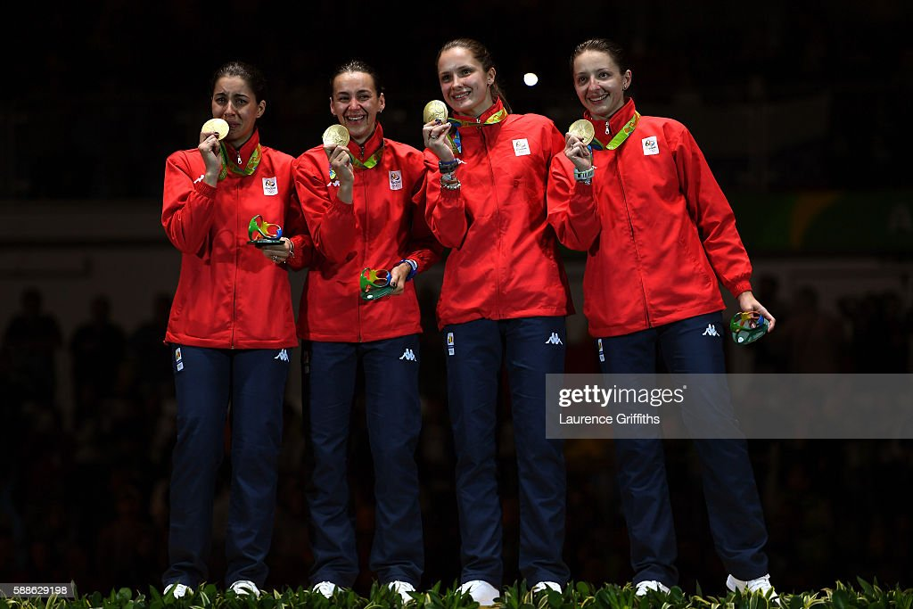 Gold medalists Loredana Dinu Simona Gherman Simona Pop and Ana Maria Popescu of Romania stand on the podium during the medal ceremony for the Women's...
